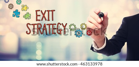 Businessman drawing Exit Strategy concept on blurred abstract background