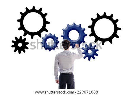Businessman drawing gear wheels, isolated on white - stock photo