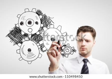 businessman drawing gears on a white background - stock photo