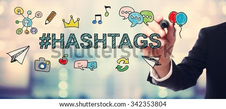 Businessman drawing Hashtags concept on blurred abstract background  - stock photo