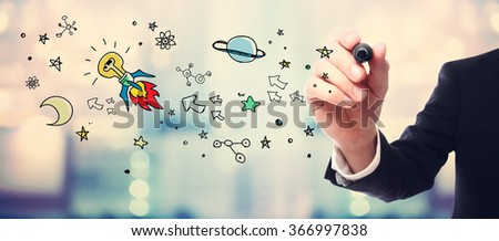 Businessman drawing Idea Rocket concept on blurred abstract background
