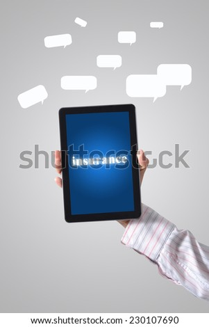 Businessman drawing insurance concept on a tablet. - stock photo