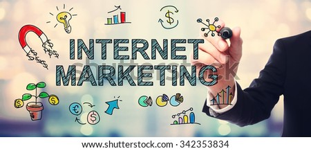 Businessman drawing Internet Marketing concept on blurred abstract background  - stock photo