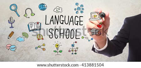 Businessman drawing Language School concept with a marker