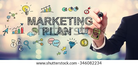 Businessman drawing Marketing Plan concept on blurred abstract background  - stock photo