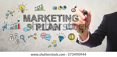Businessman drawing Marketing Plan concept with a marker - stock photo