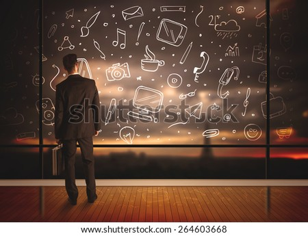 Businessman drawing media icons on glass window, bokeh cityscape background  - stock photo