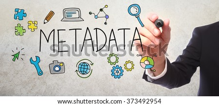 Businessman drawing Metadata concept with a marker - stock photo