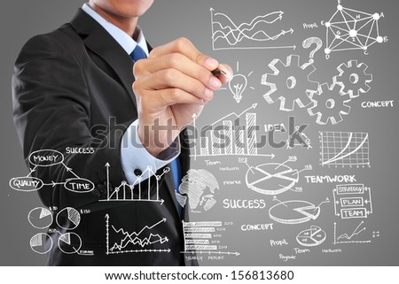 Businessman drawing modern business concept on grey - stock photo