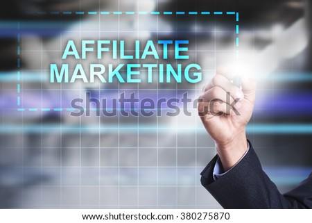 "Businessman drawing on virtual screen ""Affiliate marketing"".  - stock photo"