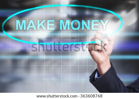 """Businessman drawing on virtual screen text """"Make money"""". Business concept. Internet concept. - stock photo"""