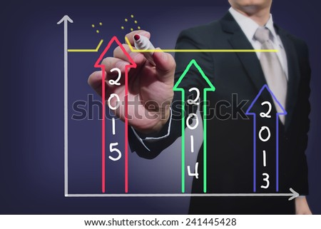 businessman drawing over target achievement graph - stock photo