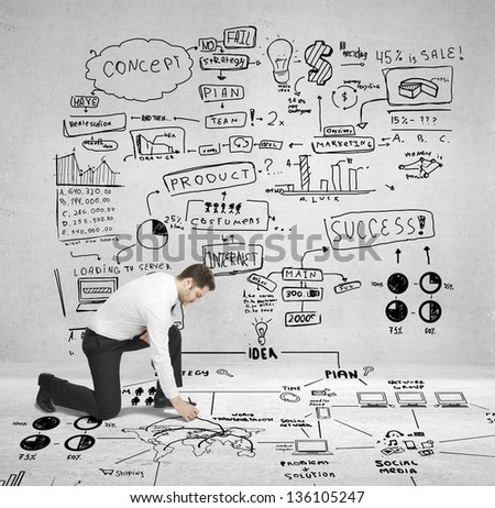 businessman drawing plan business concept on floor