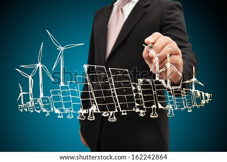 Businessman drawing renewable energy project.