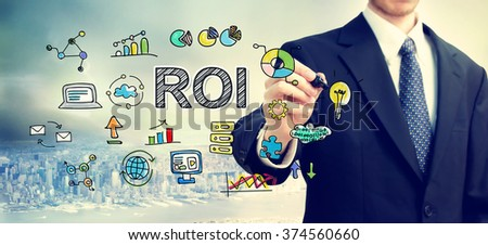 Businessman drawing ROI concept above the city - stock photo
