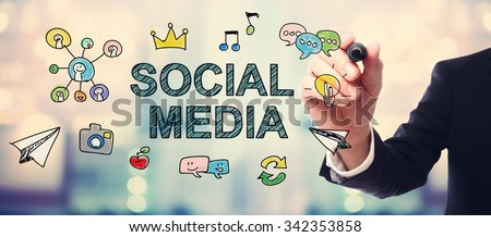 Businessman drawing Social Media concept on blurred abstract background  - stock photo