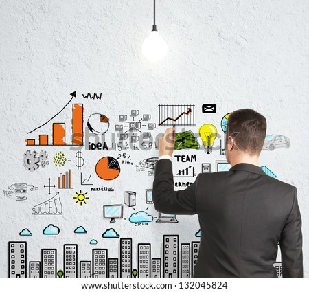 businessman drawing strategy on concrete wall - stock photo