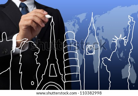 businessman drawing the concept travel around the world - stock photo