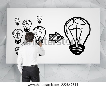 Businessman drawing the conceptual chart - how to start business.