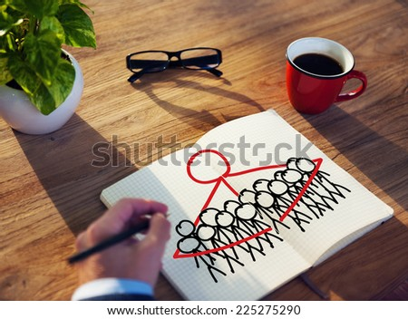 Businessman Drawing Togetherness Concept on a Note Pad - stock photo