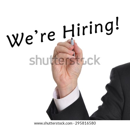 Businessman drawing we're hiring message - stock photo
