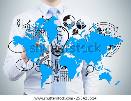 businessman drawing world map and business symbol - stock photo