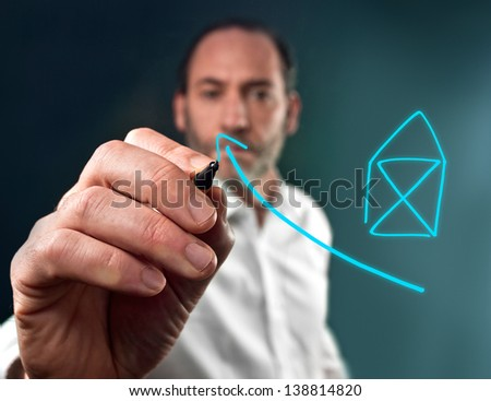 businessman draws a chart for house investment - stock photo