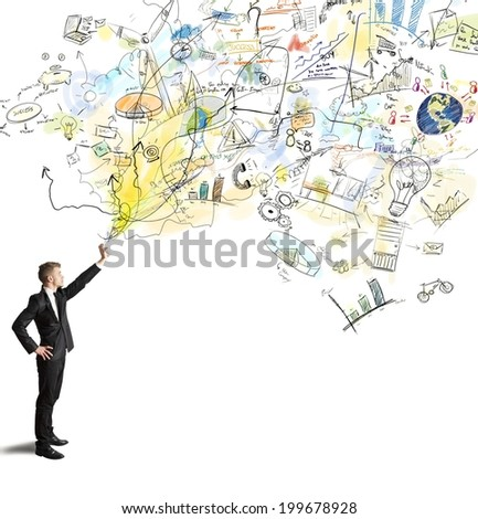 Businessman draws a creative project with spray pant - stock photo