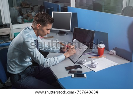 businessman draws a schedule of sales on paper