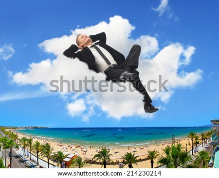 Businessman dreaming about his holidays at the beach - stock photo