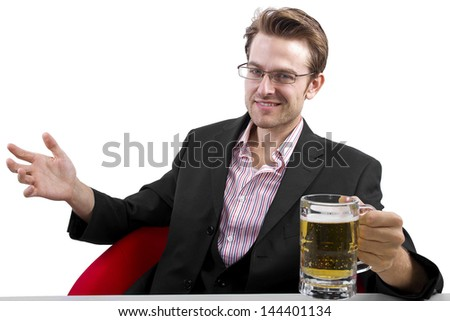 Businessman drinking beer on a white countertop