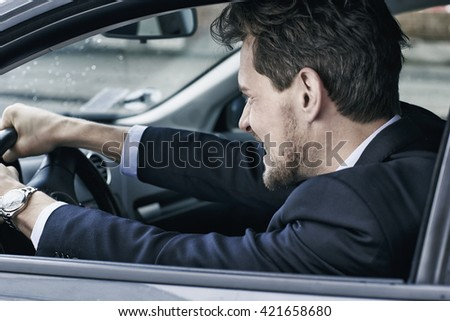 Businessman driving angry in car