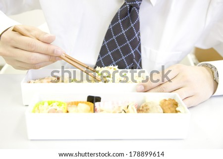 Businessman eating lunch box