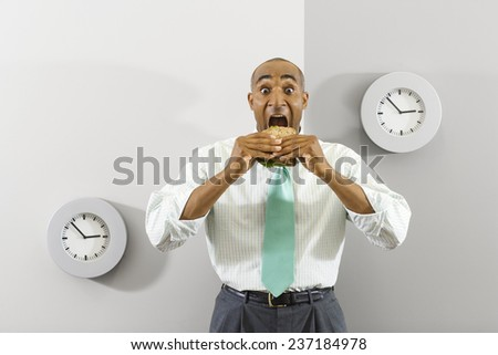 Businessman Eating Quick Lunch - stock photo