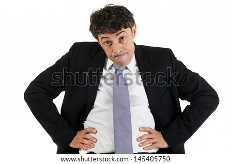 Businessman emphasizing a point standing with his hands akimbo on his hips and head lowered glaring with raised eyebrows, isolated on white - stock photo