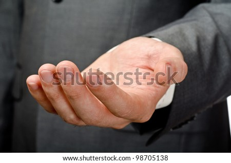 Businessman empty open hand. Studio shot