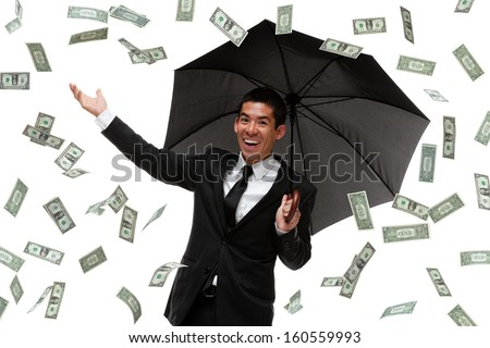 Businessman enjoying it raining money