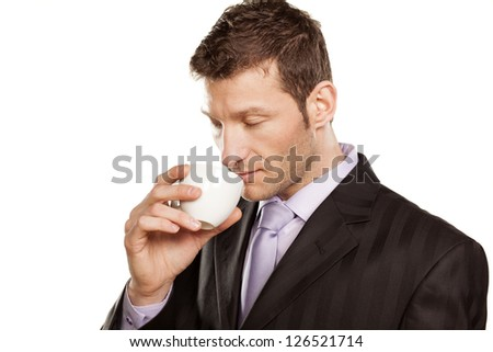 businessman enjoys the smell of his coffee on white background - stock photo