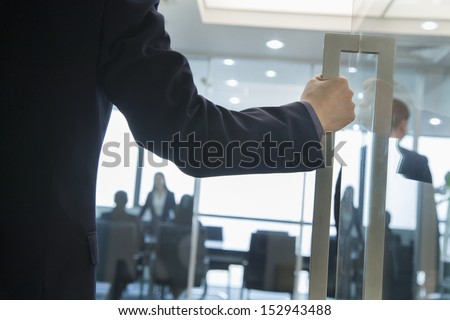 Businessman Entering an Office - stock photo