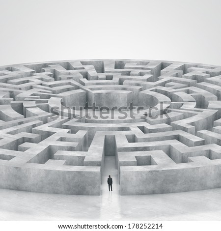 businessman enters the labyrinth - stock photo