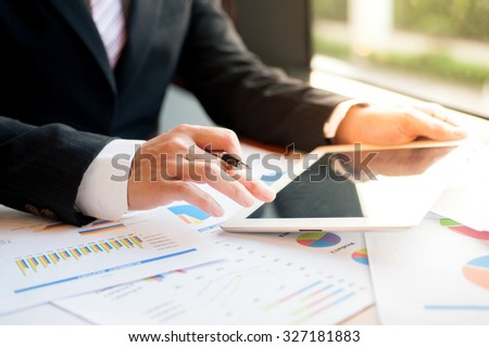 Businessman  examine finance, tax, accounting, statistics and analytic research concept