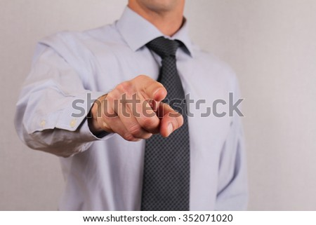 Businessman executive manager pointing at you  - stock photo