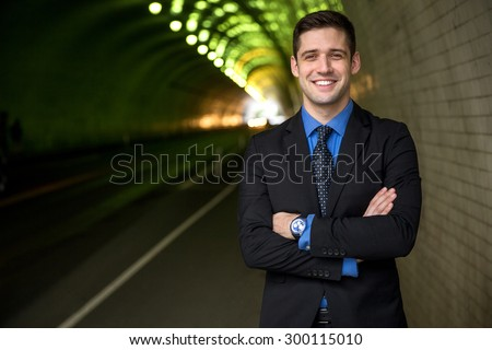 Businessman executive portrait arms crossed interesting background headshot - stock photo