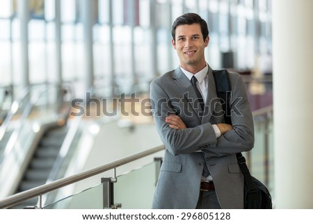 Businessman executive traveling for work at the airport station confident and successful expression - stock photo