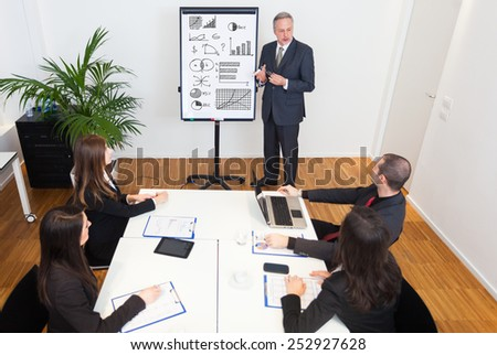 Businessman explaining business concepts - stock photo