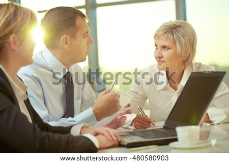 Businessman explaining his ideas and businesswomen listening to him