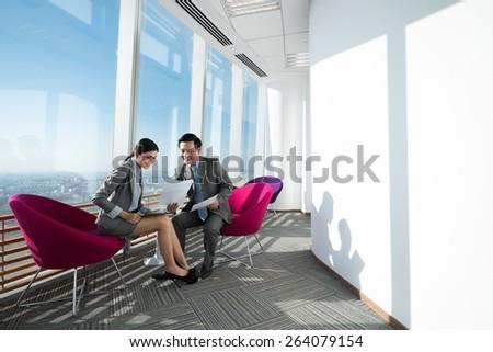 Businessman explaining ideas to his female partner - stock photo