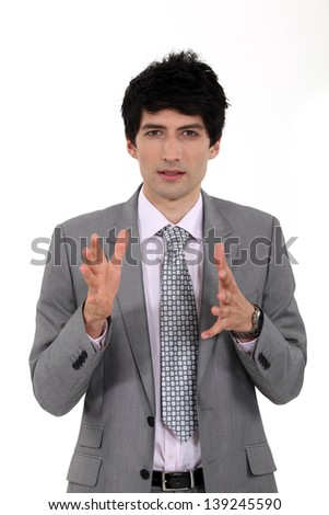 Businessman explaining something - stock photo