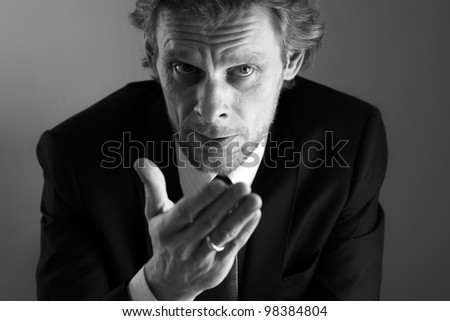 Businessman explaining with gesture of hand: non verbal communication during confrontation, discussion or negotiation. - stock photo