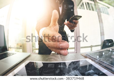 businessman extending hand to shake with digital business strategy diagram in his office as concept - stock photo
